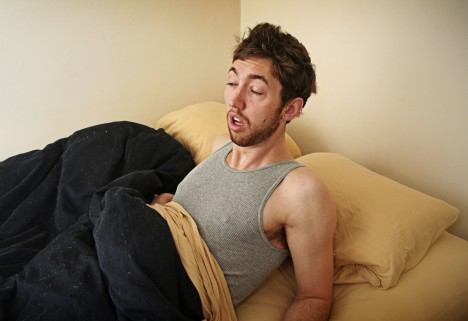 Hungover Man in Bed