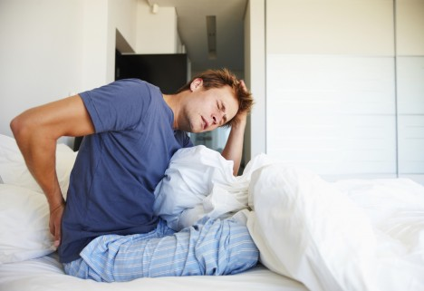 Man Waking Up With Back Pain