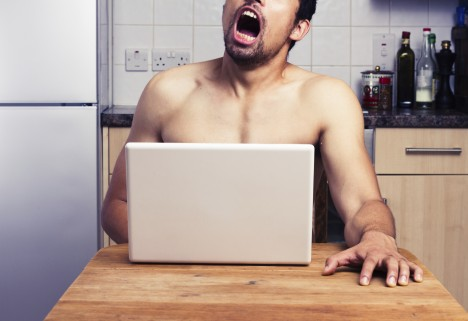 Man Watching Porn on Computer in the Kitchen