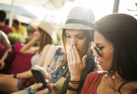 Two Women Staring Shocked at Phone