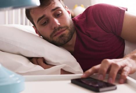 Man Shutting Off Phone Alarm