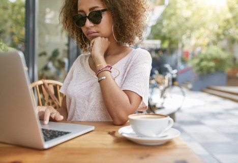 Woman at a Cafe with Laptop