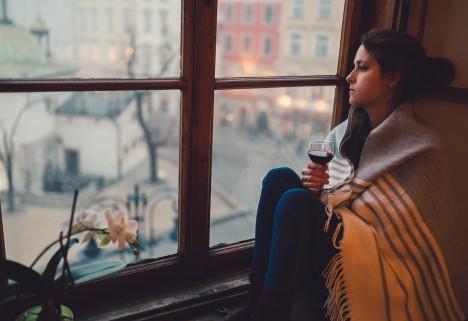 Woman Drinking by Window
