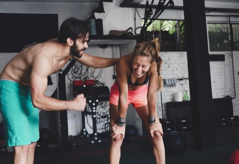 Couple working out and laughing